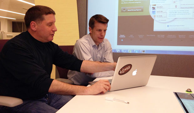 Scott DeFusco (L) Reviews Data With Kona Cofounder Jeff Eckerle